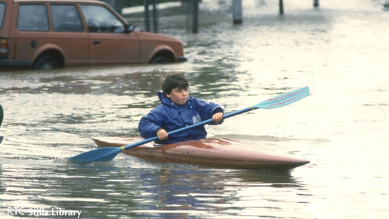 Boy canoes through the floods in Ballsbridge, Dublin in 1986. But who is he?