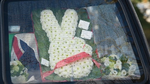 Defiant to the end - a two-fingered floral tribute in the hearse carrying Ronnie Biggs' coffin
