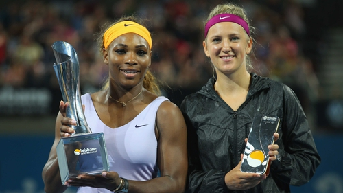 Serena Williams (L) poses with the winners trophy and Victoria Azarenka poses with the runner up trophy