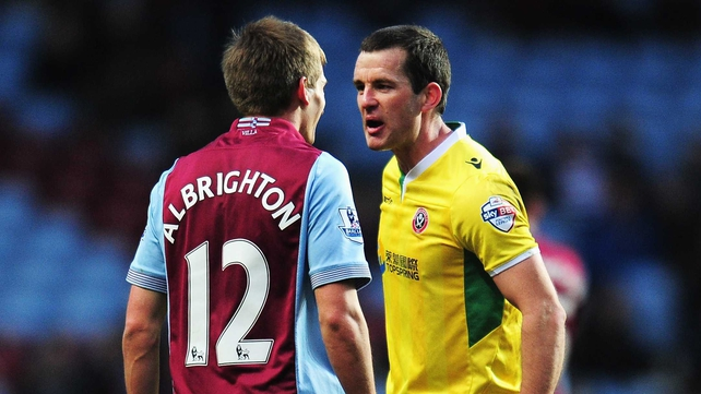 Michael Doyle of Sheffield United confronts Marc Albrighton