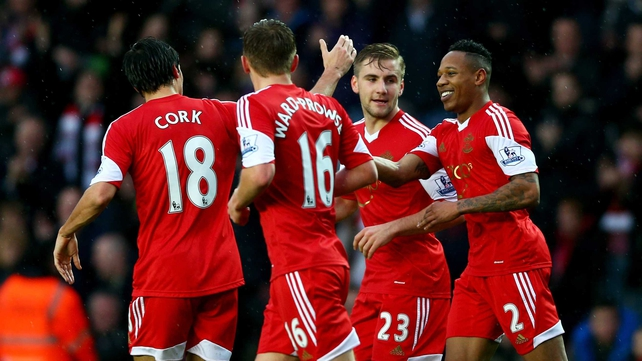 Nathaniel Clyne of Southampton (R) celebrates with team mates after he scored the first