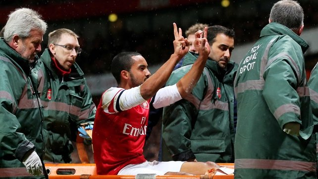 Theo Walcott suffered the injury against Spurs, but took time to remind their fans that Arsenal were winning