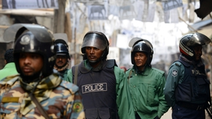 Bangladeshi riot police patrol a neighbourhood where several local polling stations are located in Dhaka