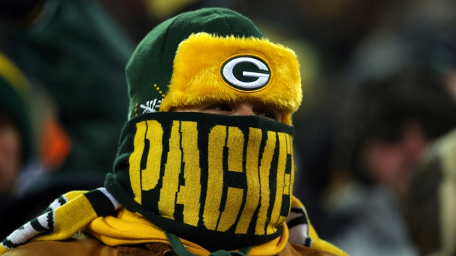 A Green Bay Packers fan wraps up to watch his side play the San Francisco 49ers in the NFL play-offs