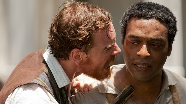 Michael Fassbender and Chiwetel Ejiofor as Solomon Northup in 12 Years a Slave