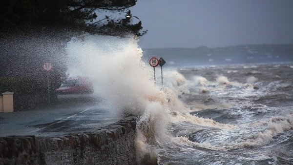 Waves crash over the wall at Clonea Strand in Dungarvan (Pic: Barry Naughton)