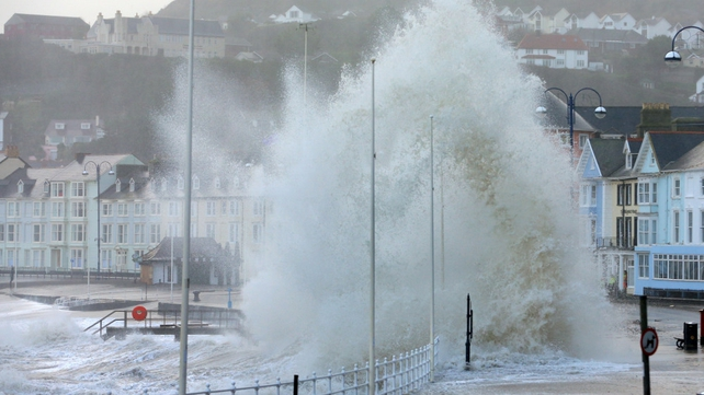 Waves crash against the Aberystwyth coastline as strong winds and high tides continue to blow in from the west