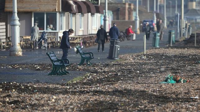 Beach shingle covers the promenade after stormy weather in Hove