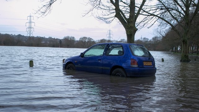 A car sits in flood water near Osney Industrial Estate in Oxford