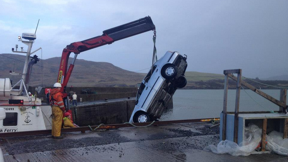 A car is lifted from the water at Cleggan Pier (Pic: Shane Bisgood)