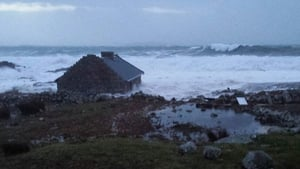 A cottage at Roundstone, Co Galway is battered by waves (Pic: Martha Ryan)