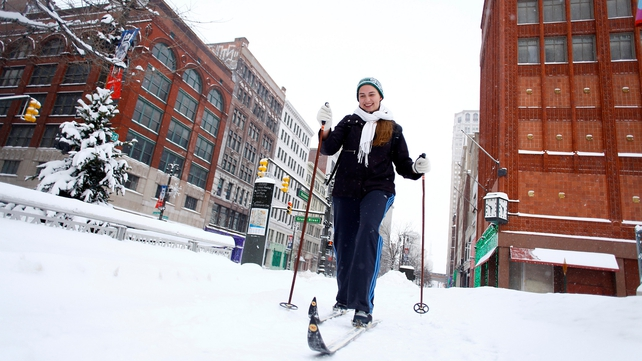 A woman uses her skis to get to work in Detroit