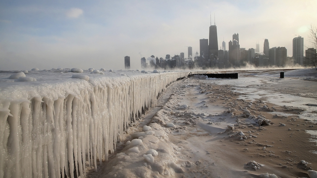 Ice builds up along Lake Michigan at North Avenue Beach in Chicago