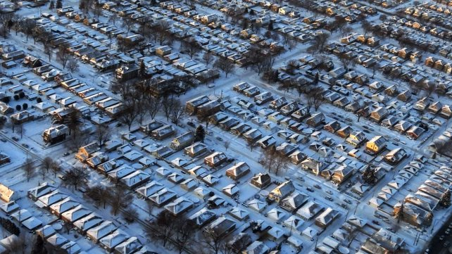 Houses and streets are covered with a blanket of snow in Chicago, Illinois