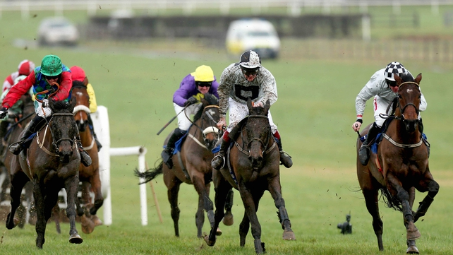 Mad Brian (centre) makes a quick resumption in a Novice Chase at Navan