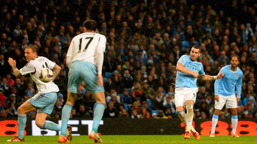 Alvaro Negrado bagged a hat-trick as Manchester City ran riot in the first leg