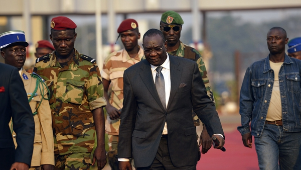 Central African president Michel Djotodia (C) arrives at Mpoko Bangui airport on his way to N'Djamena