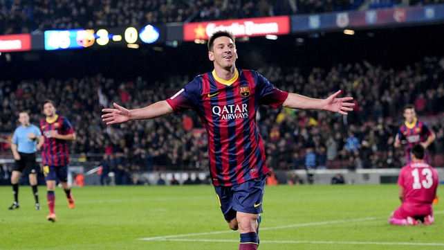 Lionel Messi celebrates scoring the first of his two goals at the Nou Camp