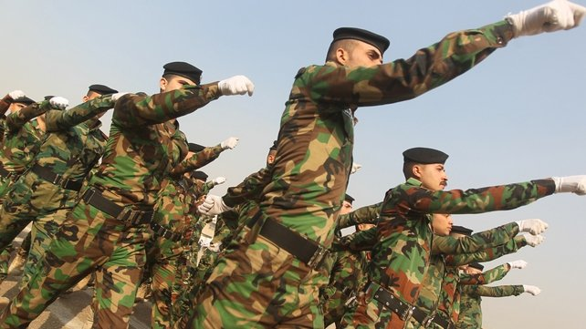 Iraqi soldiers parade during a ceremony marking police forces 92nd anniversary in the capital Baghdad