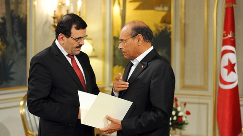 Ali Larayedh (left) submits his resignation to Tunisian President Moncef Marzouk