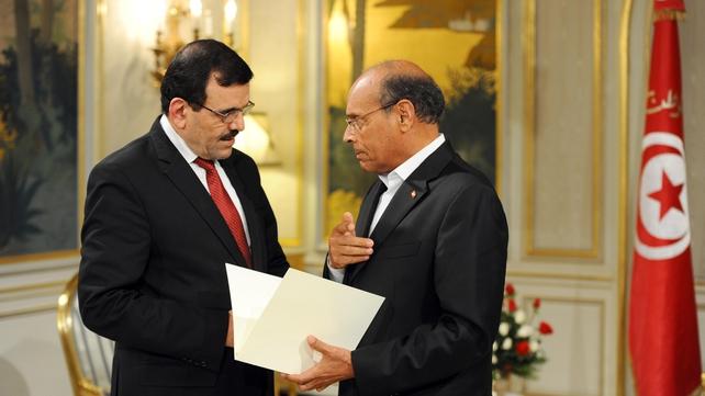 Ali Larayedh (left) submits his resignation to Tunisian President Moncef Marzouk