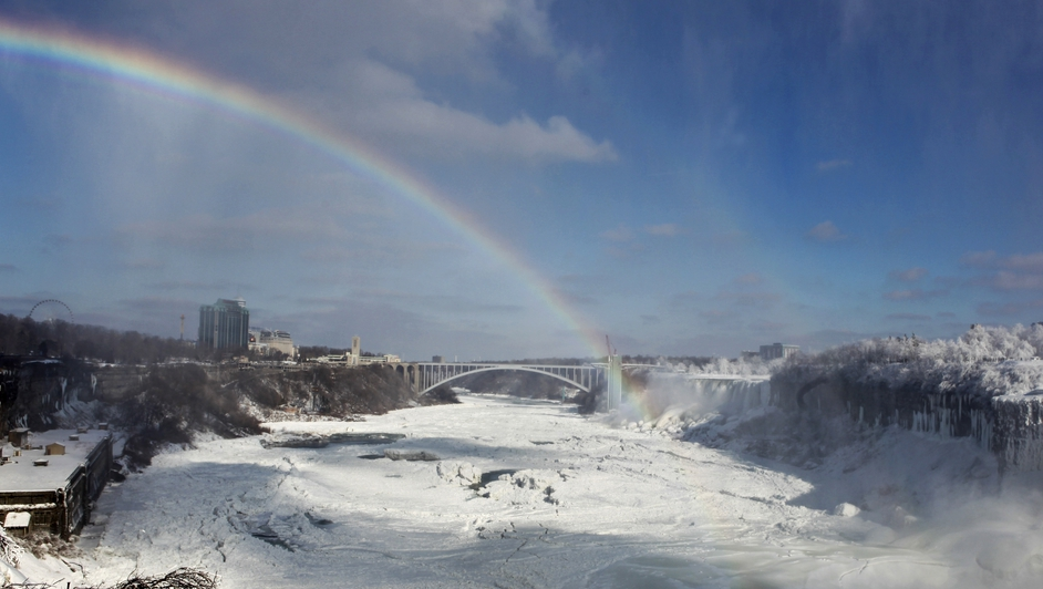 A rainbow is seen among the ice and ice floes at Niagara Falls