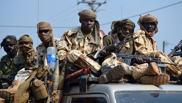 Chadian troops of the African-led International Support Mission to the Central African Republic (MISCA) patrol following the resignation of the Central African Republic president in Bangui