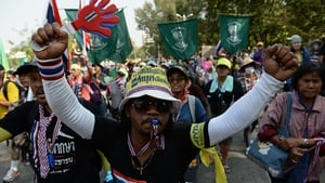 Thai anti-government protesters marching through the streets of Bangkok on Thursday