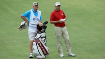Padraig Harrington explains how a photographer ended up caddying for him in Durban.