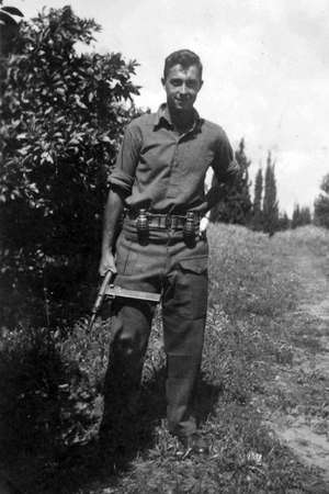 Mr Sharon holds a Sten gun as a young commander in the Alexandroni Brigade of the fledging Israeli army during the War of Independence in 1948
