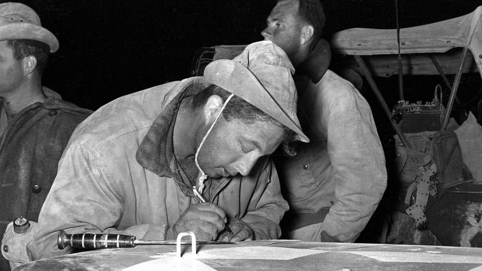 Mr Sharon writes a note on the hood of a jeep before the attack on the Mitla Pass during Operation Kadesh in 1956