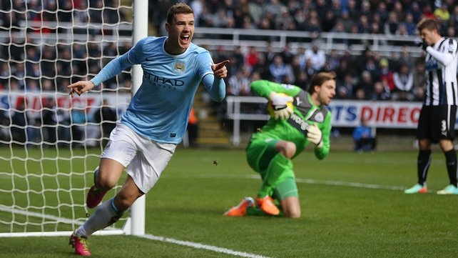 Edin Dzeko celebrates after giving Man City an early lead