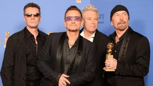 U2 singer Bono paid tribute to Nelson Mandela after winning the award