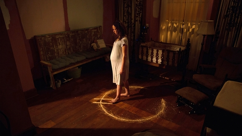 Samantha (Allison Miller) is locked in her nightmare in Devil's Due - a strange notched circle symbol, Latin incantations and voodoo