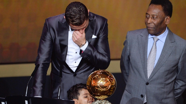 Cristiano Ronaldo accepted the award from Pele