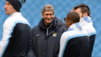 Man City manager Manuel Pellegrini says they are aiming to win all four competitions they are entered in.