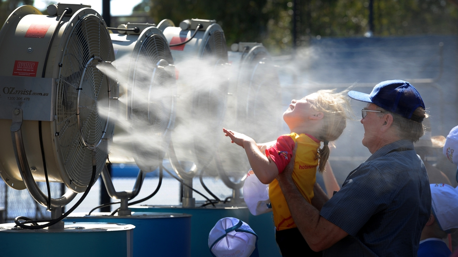 Tennis fans cool off during the heatwave at the Australian Open tennis tournament in Melbourne