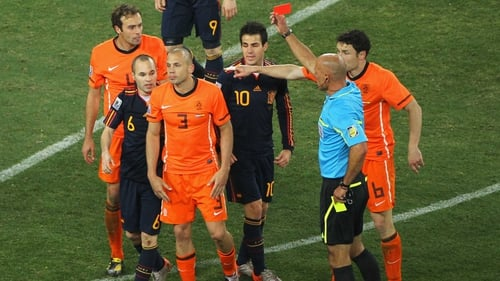 Howard Webb shows John Heitinga of the Netherlands a red card at the 2010 World Cup final