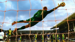 John Ruddy of Norwich City fails to stop a free kick by Kevin Mirallas of Everton during their Premier League tie
