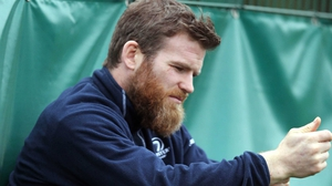 Gordon D'Arcy looks through his phone in vain for the number of a good barber