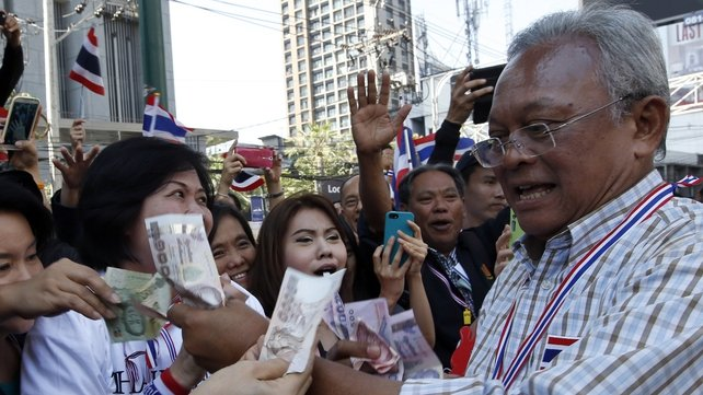 Rally leader Suthep Thaugsuban (right) faces an insurrection charge, theoretically punishable by death