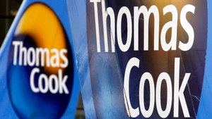 Thomas Cook said it was considering proposals to align its money unit more closely with the tour operating business.
