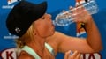 Sharapova advances in Oz as heat debate continues