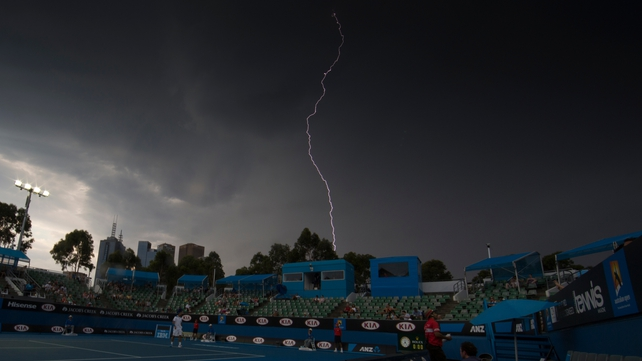 Lightning strikes the sky during play at the Australian Open in Melbourne