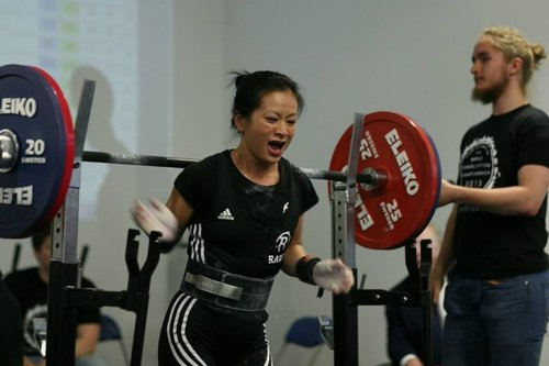 Linh celebrates after her lift