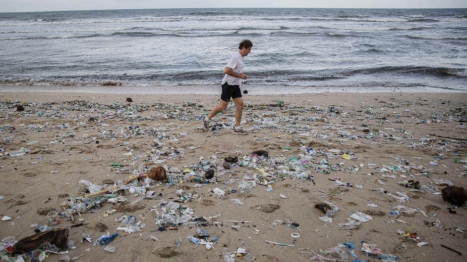 A man jogs along amid the litter