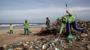 Teams pile up the debris