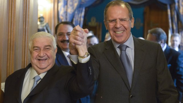 Walid Muallem (left) made the announcement after meeting Russian Foreign Minister Sergei Lavrov in Moscow