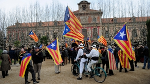Secessionists gather outside Catalonia's parliament during a vote for a petition to the national parliament, in Barcelona