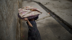 An Afghan child carries bread through the old quarters of Kabul